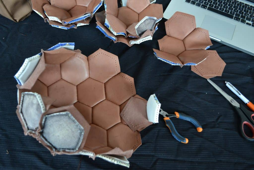 hand recycling soccer ball to hand bag