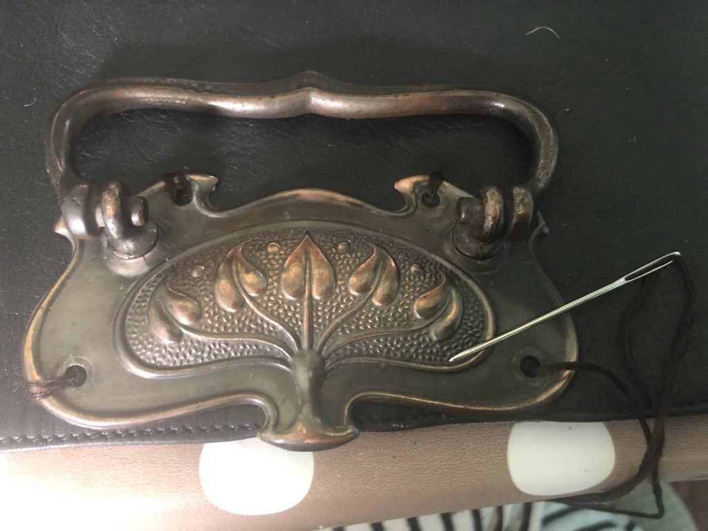 sewing buckle onto purse