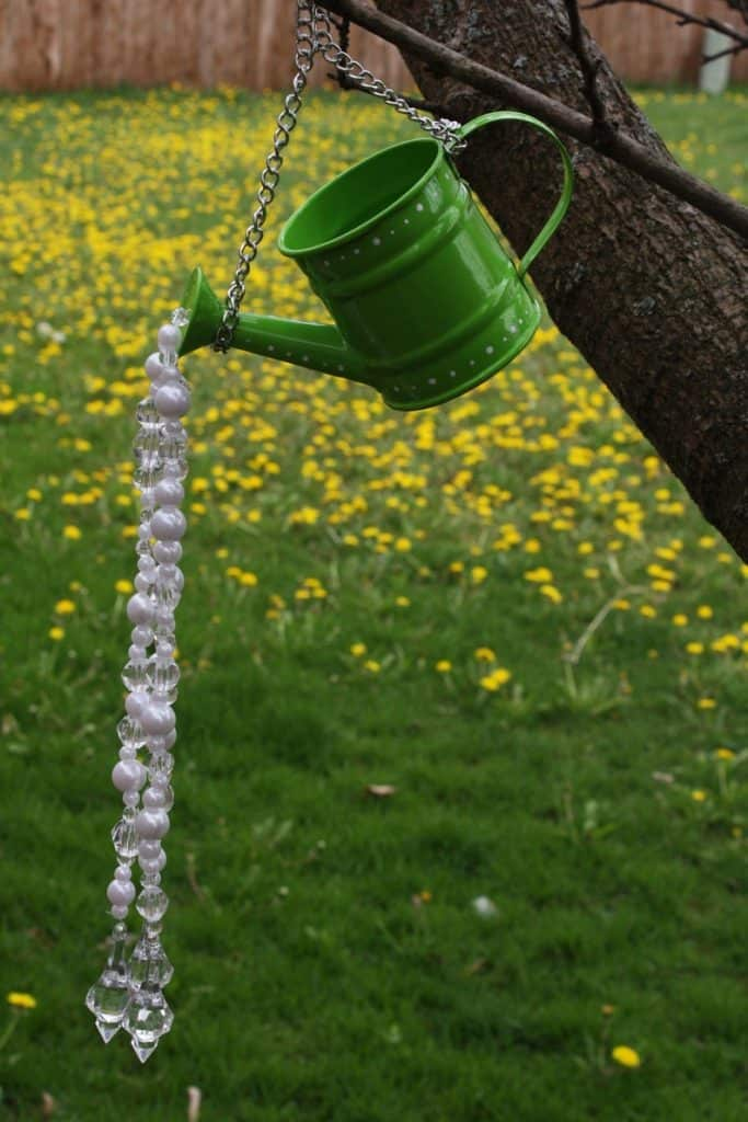 watering can upcycled to wind chime