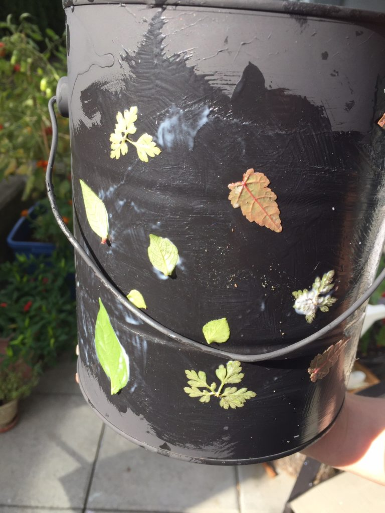 decoupage planter using empty paint can