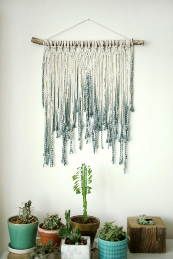 blue and white macrame wall hanging