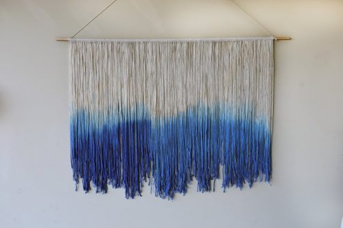 blue and white yarn wall hanging