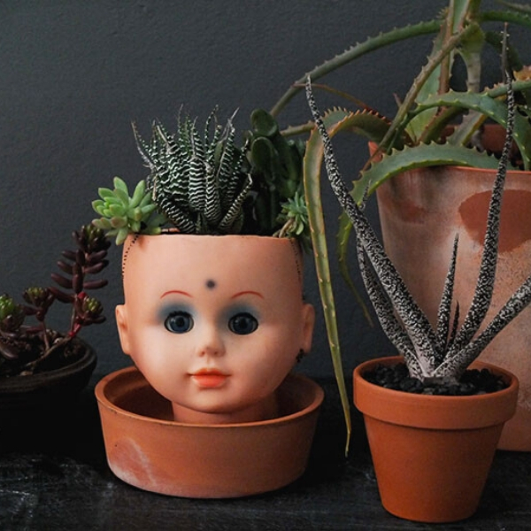 doll head upcycled planter