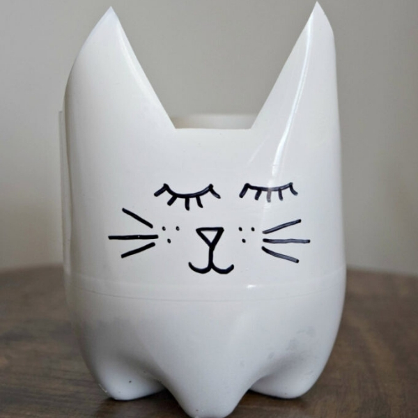 cat face upcycled planter from a plastic bottle