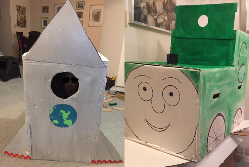 two cardboard playhouses train and rocketship
