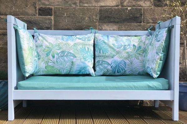 how to repurpose a cot bed as a garden bench