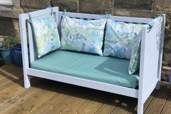upcycled cot bed to garden bench