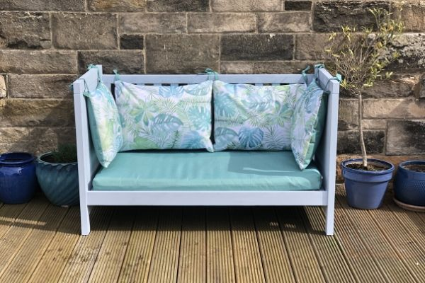 upcycle a cot bed into a garden bench