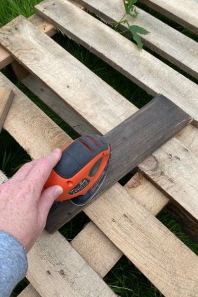 sanding pallet wood for diy coat rack