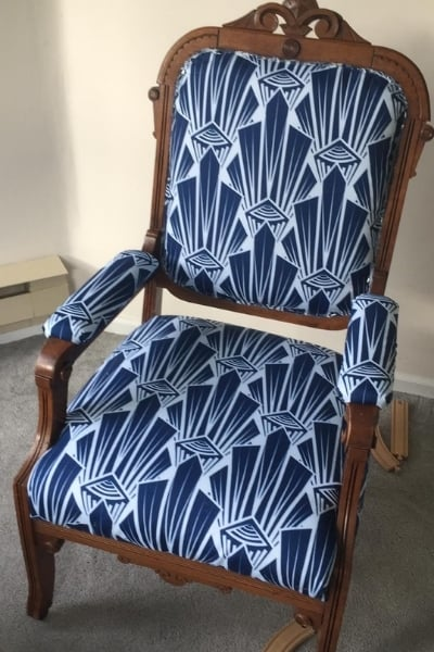 how to reupholster a dining chair - stapling on the fabric