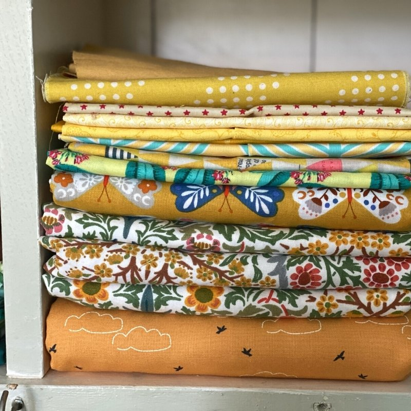 sewing room folded fabric storage