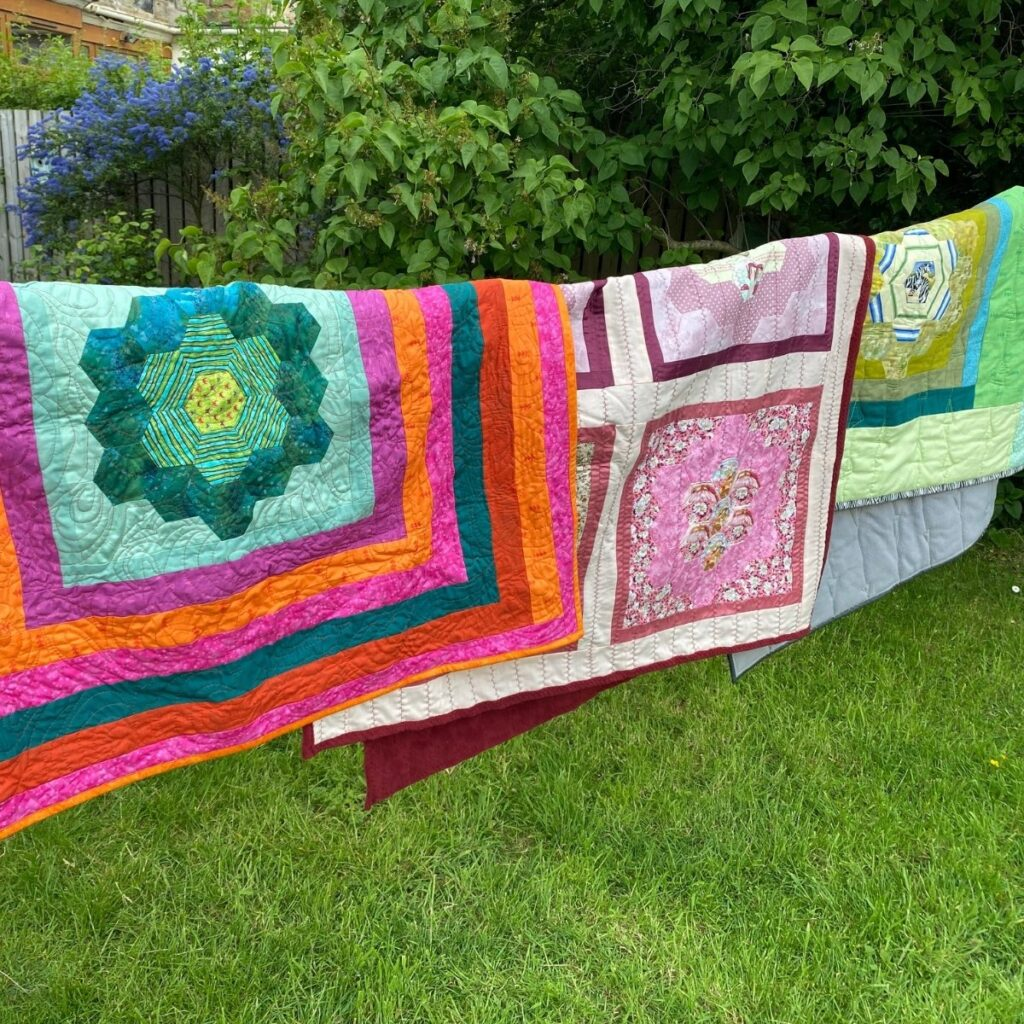 three quilts with fleece backing